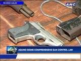 Aquino signs comprehensive gun control law