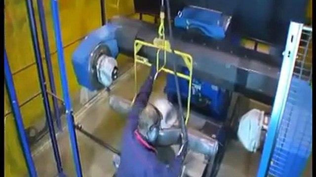 Motoman robot welding a heavy truck rear axle