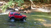 RC 1:10 Scale 4x4. Axial SCX-10 with Land Rover LR3 body. Some Rock Climbing and River Crawling.