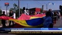 Unire simbolică între România şi R. Moldova. Un tricolor lung de 300 de metri a acoperit astăzi podul de peste Prut de la Sculeni. Steagul a fost purtat de peste 100 de persoane, români şi moldoveni, care au cerut ReUnirea.