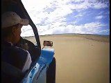 Driving a dune buggy on the sand dunes in Australia