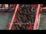 Aerial view: Naked Naga sadhus cross Ganga bridge in Haridwar