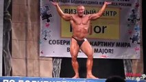 Russian bodybuilder dance like a Bollywood film star and then a chicken during a competition