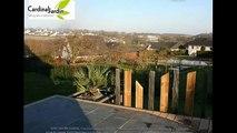 Bois composite ardoise et palmier, la création d'une terrasse bois composite contemporaine.