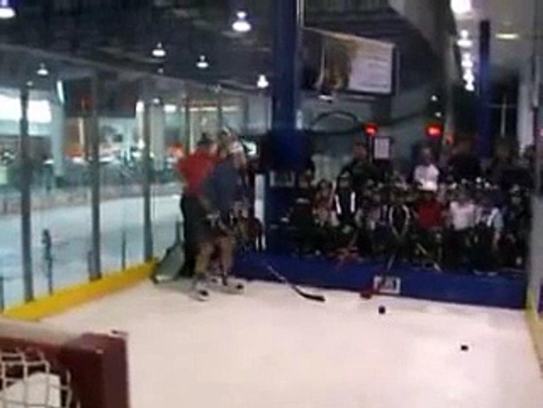 Canadian kids learning hockey skills.