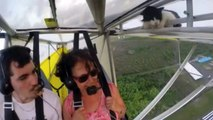 Watch pilot's disbelief as CAT crawls from wing of plane hundreds of feet above the ground