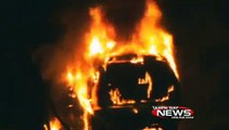 Firefighters put out fully involved van fire