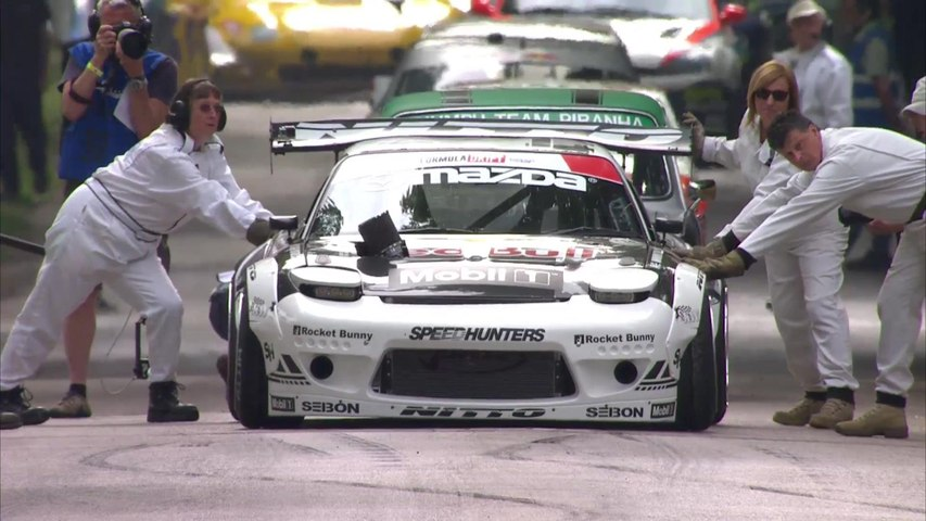 Mad Mike Drifting the Red Bull RX7 up the Goodwood Hill - Full Version