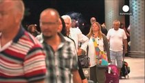 Thousands of tourists flee Tunisia after deadly beach hotel attack