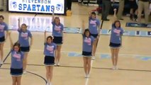 Stevenson cheerleaders perform during timeout at Churchill basketball game