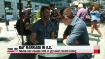 Same-sex couples still in joy of legalization of gay marriage in U.S.