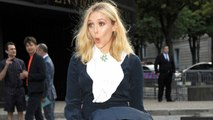 OOPS! Elizabeth Olsen Channels Marilyn Monroe with a Wardrobe Malfunction at Paris Fashion Week!