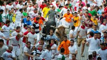 Running from bulls through the streets of Pamplona