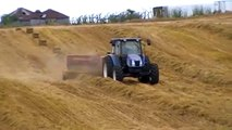New Holland T5060 Baling Straw with a New Holland BC5070 Square Baler