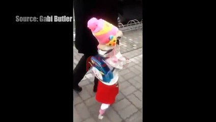 Dog dresses up like kid, walks around with owner