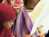 Young child reciting Quran very beautifully, its amazing Watch!!