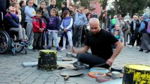 Amazing street drummer plays Techno Rave music on the floor