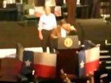 Rick Perry presents George Bush at a Rally amidst Protestors