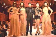 'Calendar Girls' unveiled among bikinis and scantily clad models