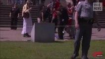 -KKK members burn the Israeli flag-