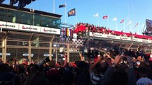 2011 Australian Formula 1 Grand Prix: Podium celebration from the crowd on main straight