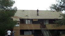 Insane bicycle stunt jump from rooftop down stairs!