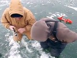SUPER CRAZY AWESOME Ice fishing video of a big brown trout fighting under glare ice.AVI