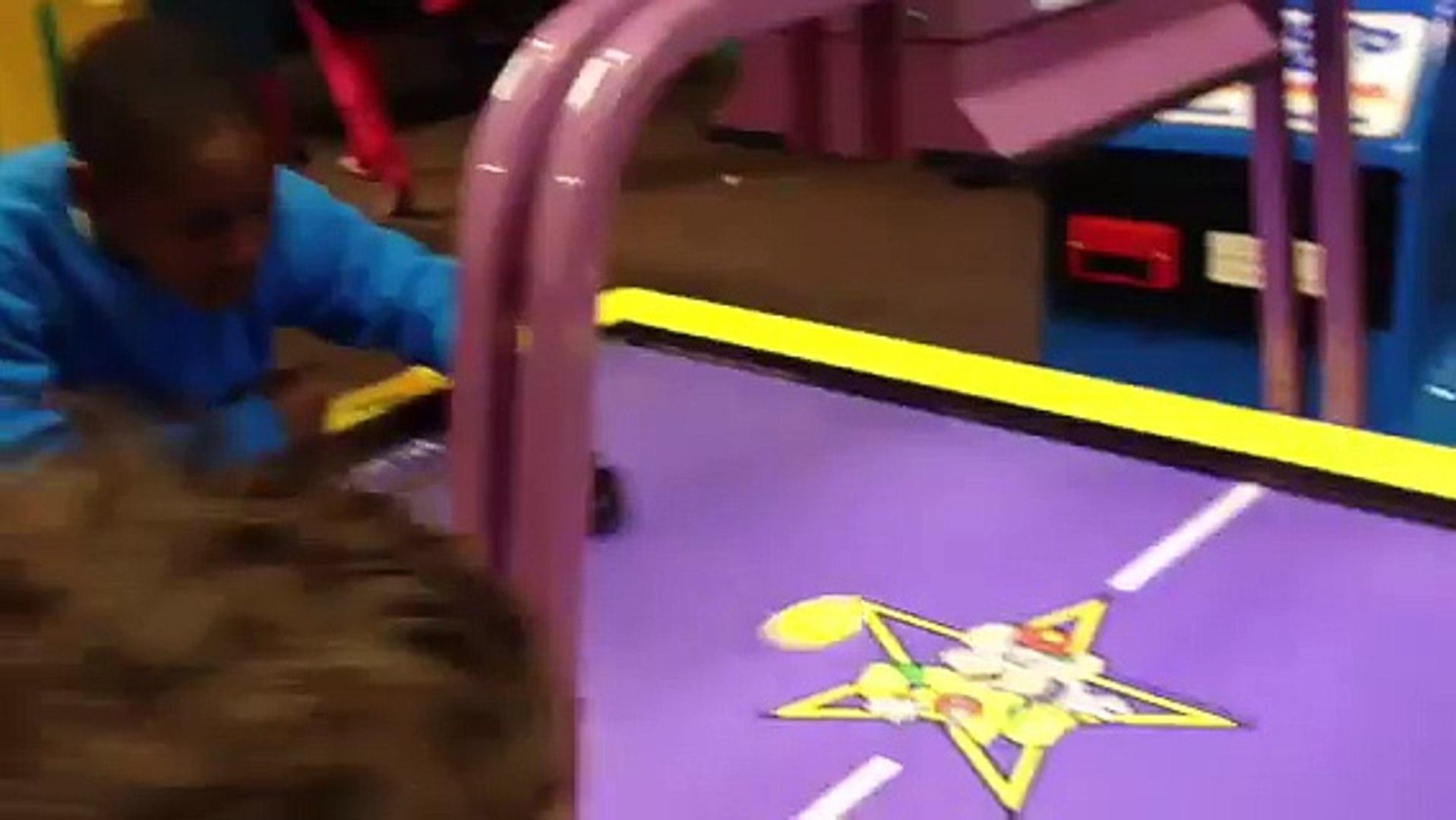 Air hockey game kids playing