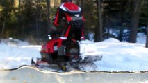 snowmobiling over a swinging rope bridge in Marquette County Michigan