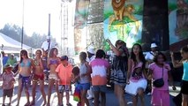 """Pato Banton; Live, """"King Step"""" on stage dances with the children."""