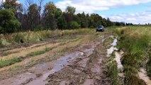 Toyota Hilux going through Mud, 4x4