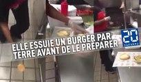 Une employée essuie un burger par terre avant de le préparer