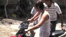 Girl Crashes Moped Very Funny