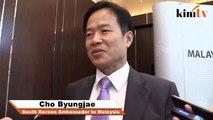 Korean ambassador laughs off hugging incident
