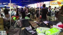 Thousands of protesters paralyse HK  under heavy rain