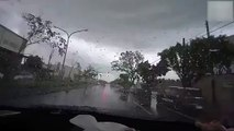 Watch What Happened With This Moving Car in Seconds hit by a small Tornado, Really Shocking