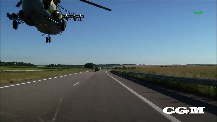 Russian Helicopter Flying On The Highway