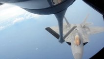 Air Force KC-135 refuels F-22 Raptors in mid-air