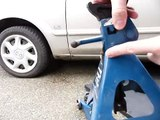Lift a car safely using a jack and an axle stand