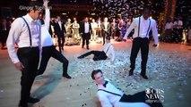Groom, groomsmen surprise bride with epic dance routine