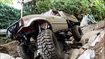 rc scale Trail Finder 2 - 1.9 Pit Bull Rock Beast tires - backyard rock crawling course