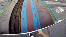 guy jumps onto and surfs a moving train.