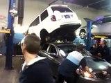 SUV Falls Off Hoist Onto Other Car - FAIL!