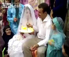 The groom slaps bride in front of family