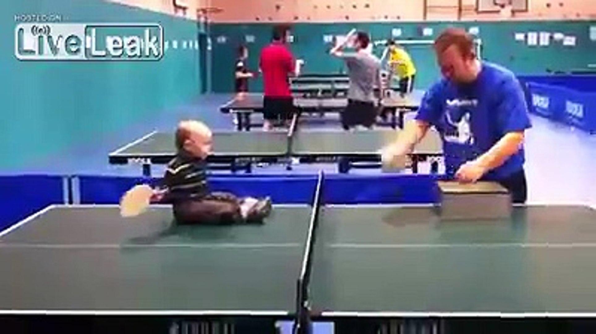 Kid playing ping-pong