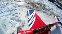 Flying on a radio-controlled plane, 3D aerobatics.