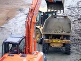 Excavator digs rocky seabed in Guernsey Harbour (Part 1 of 2)