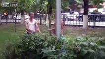 Two Russian Masters Of The Martial Arts Put On A Display In A Public Park.