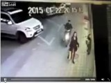 Purse snatcher on motorcycle in Malaysia