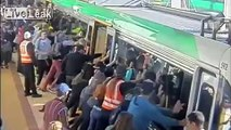 People power has been used to free a man who became trapped between the platform and a train